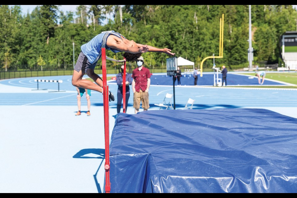 Citizen Photo by James Doyle/Local Journalism Initiative. Bobby Kelly clears the high-jump bar on Saturday morning while competing in the Spruce City Invitational track and field meet at Masich Place Stadium.