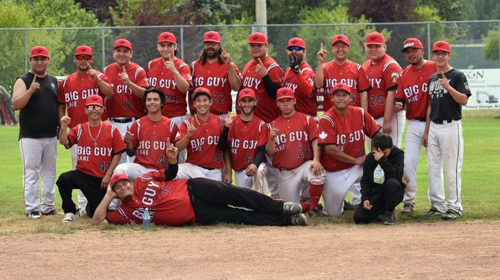 The LTN Contracting Reds, also known as Big Guy Lake, celebrate their 5-4 win over the Decorum Painting Angels Sunday in the final of the Spruce City Men's Fastball Icebreaker Tournament at Spruce City Stadium.