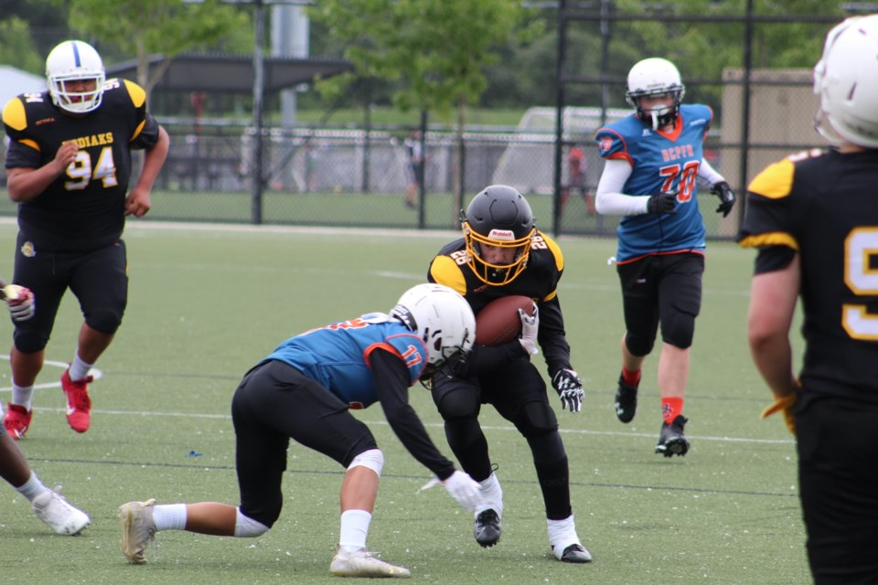Prince George U-16 Kodiaks ball carrier Peyton Briere tries to avoid a tackle during Saturday's BCPFA Academy Tournament in Surrey.