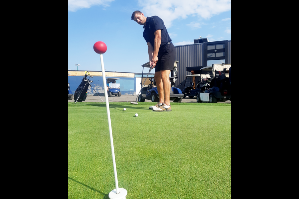 Former Cougar defenceman Dan Gibb practices his putting before going out on the course for the Cougars Alumni golf tournament Saturday at Prince George Golf and Curling Club.