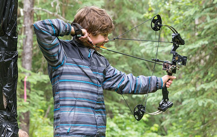 Nine-year-old Kalem Schultz draws back his bow and gets a 3-D target in his sights on Saturday morning at Keith Paterson Field at the Silvertip Archers outdoor facility on Highway 16 East while particpating in the Silvertip Archers Outdoor 3-D competition. Approximately 100 people took part in the weekend event with archers coming from all over B.C., including Prince George, Vanderhoof, Quesnel, Maple Ridge, and Vernon.