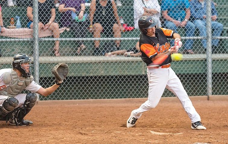 Big Guy Lake River Kings batter Randy Potskin makes contact with the ball against the STK Orioles on Sunday night at Spruce City Stadium in the championship game of the John Cho Cup.