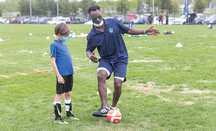 A young player in the 9-12-year age division gets some instruction from a coach during a weekend practice session for Northern United SC at PGSS fields.