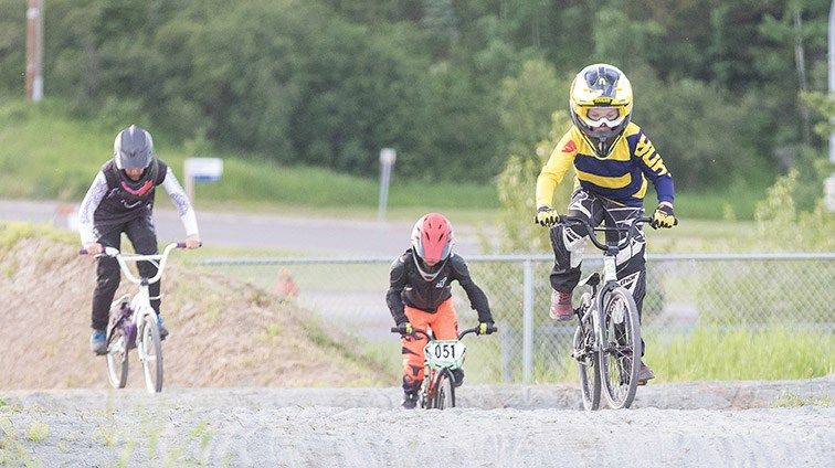 Citizen Photo by James Doyle/Local Journalism Initiative. Riders make their way around the Supertrak BMX track on Thursday evening during the first practice of the season.