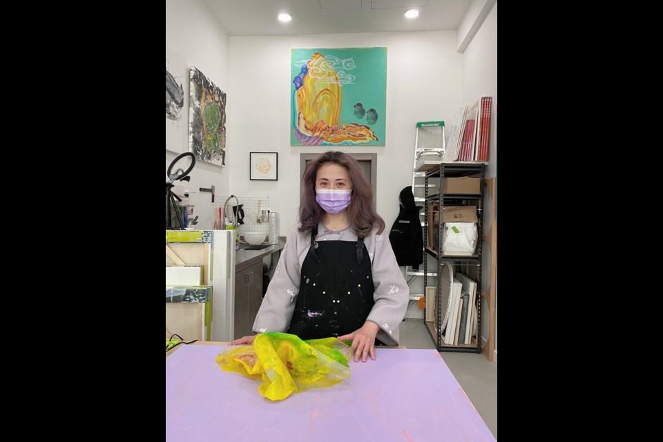 Fanny Bok Yin Tang is at her art studio.