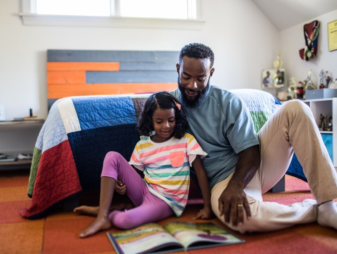 Daughter and Father reading together