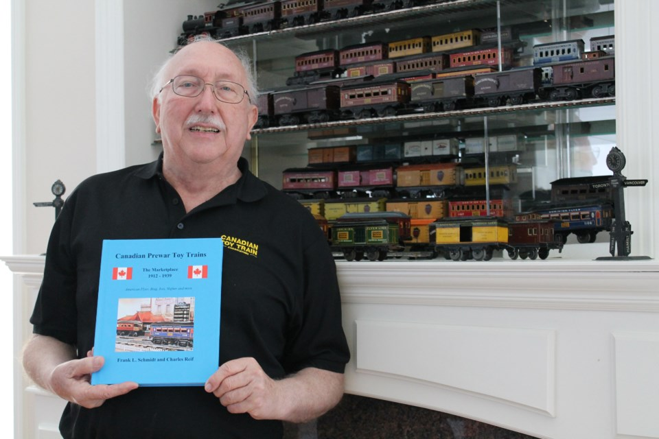 Richmond resident Frank Schmidt with his recently published book on the Canadian toy train retail industry.