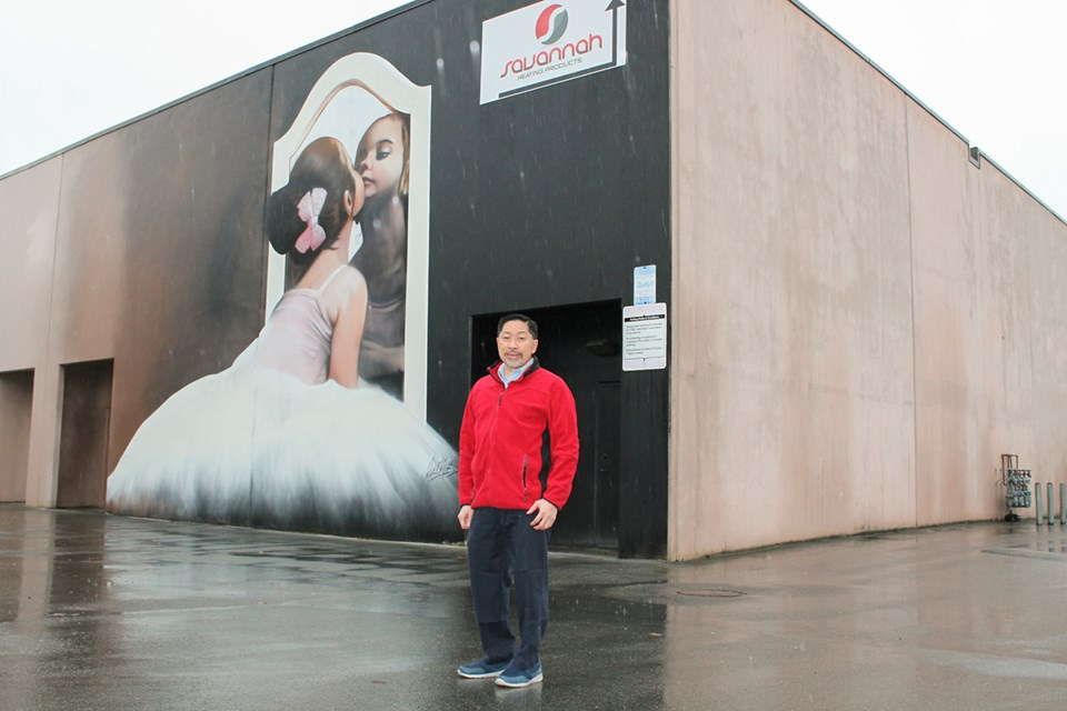 Winston Sayson with the ballerina mural in Richmond painted by artist Paul Archer.
