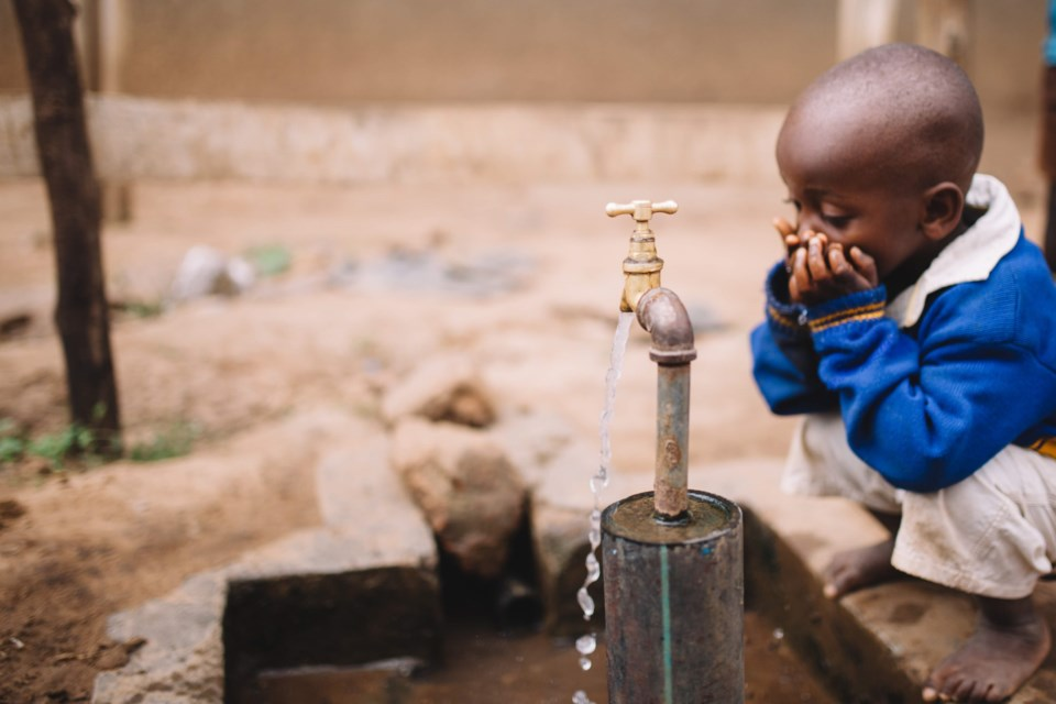 An  example of a tap stand that was built in Uganda by volunteers and staff with Acts for Water