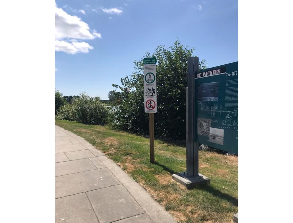 Cycling signs at Steveston Imperial Landing boardwalk