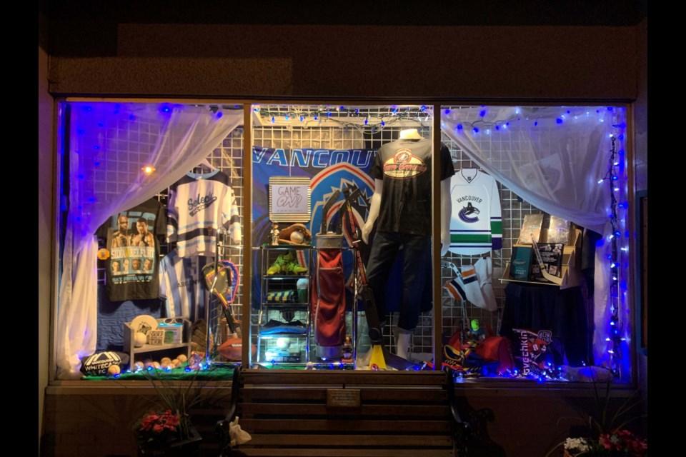 SOS Children's Village's Canucks themed window