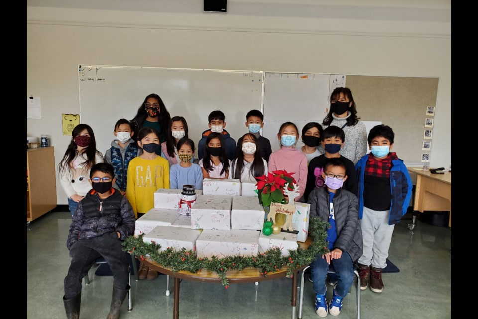 The Grade 3 Grauer elementary students who packaged the family fun boxes.