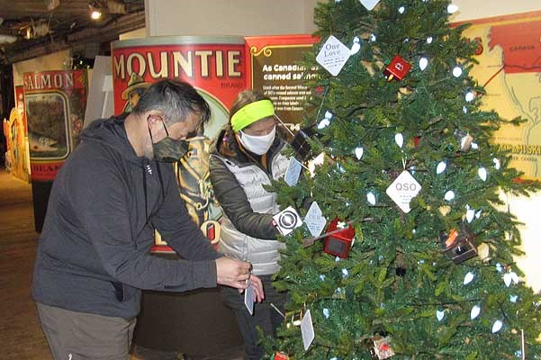 Richmond Amateur Radio Club members decorate their tree at the Gulf of Georgia Cannery.