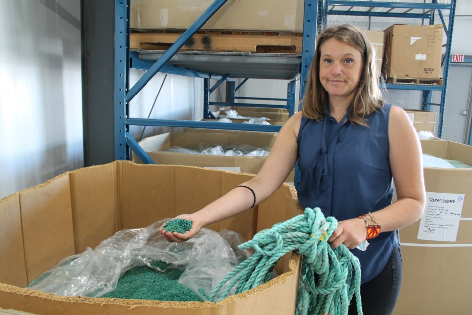 Chloe Dubois, co-founder and president of Ocean Legacy Foundation, with some of the plastic pellets produced at the non-profit's new processing facility in Steveston.