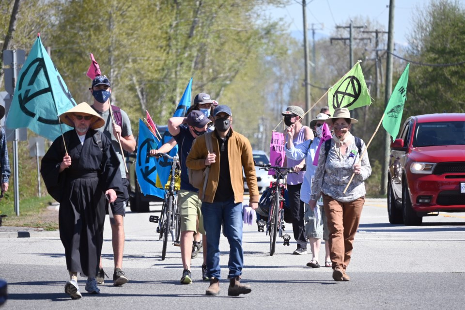 After disembarking from the bus provided by the City of Richmond on Saturday, demonstrators with Extinction Rebellion Vancouver continued their walk through Delta to the ferry terminal. This is the second day of their four-day trek.