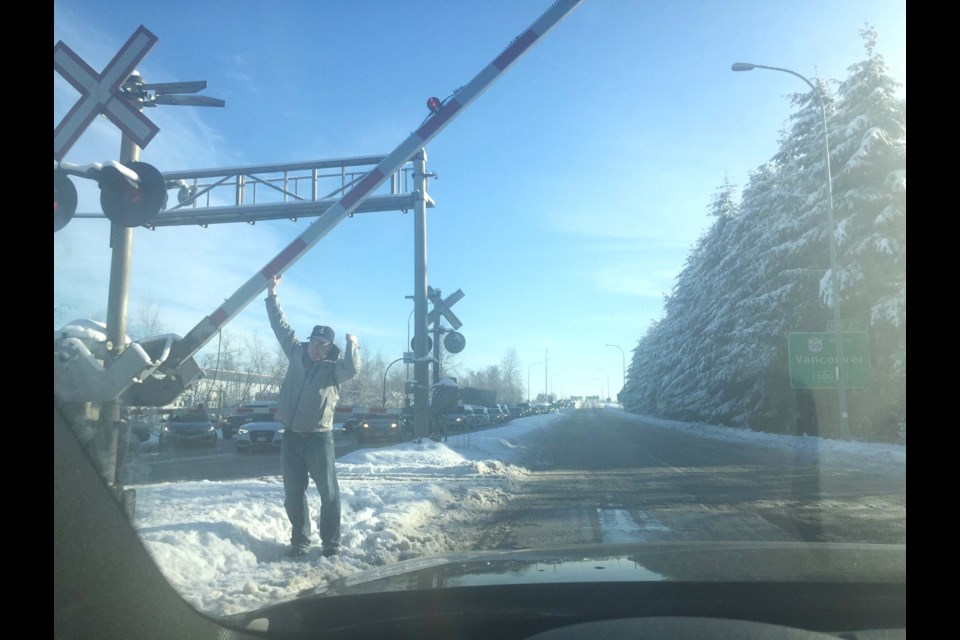 The weather chaos leaked into the fourth day, when drivers had to get out and lift the railway crossing arm themselves