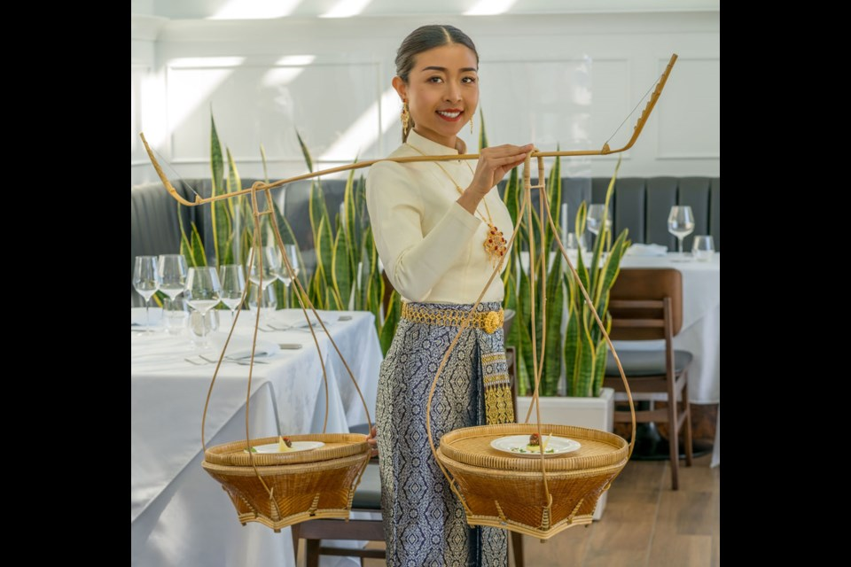 Baan Lao's Signature Dinner Experience includes a welcome dance by a traditional Thai dancer and dramatic food presentation.