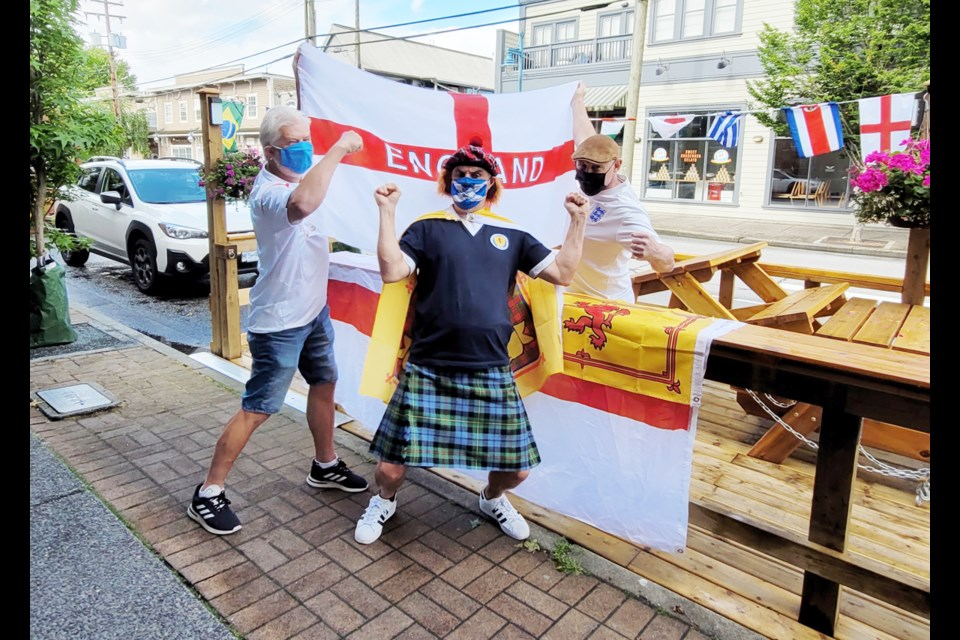Richmond News reporter and Scotland native Alan Campbell (centre) comes face to face with Iain MacKelworth (right) and Andy Stokes, both die-hard England fans