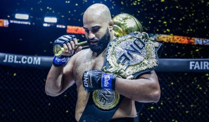 Richmond's Arjan Bhullar lifted the ONE Championship world heavyweight title on Saturday morning in Singapore