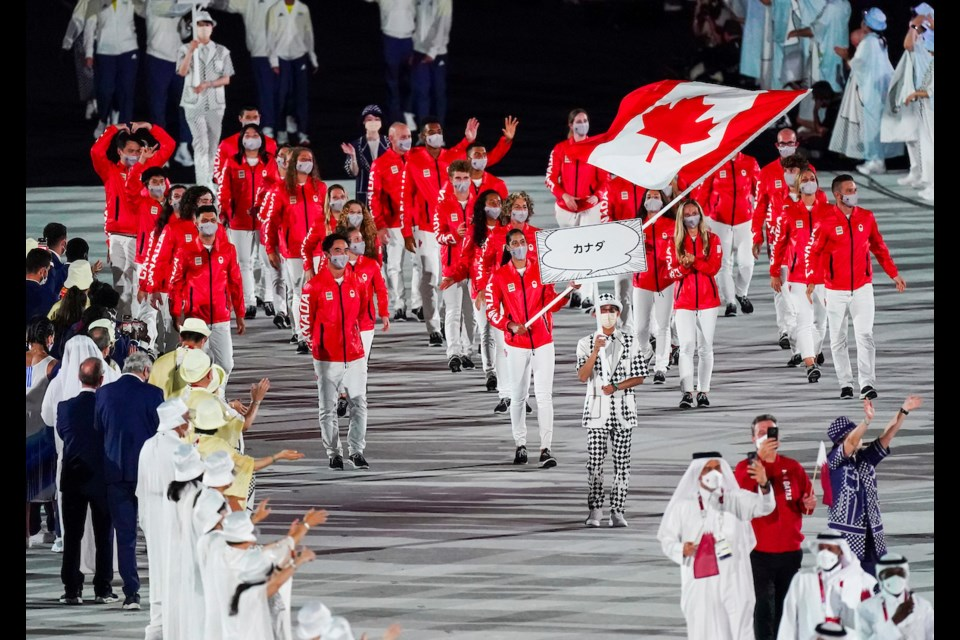 Canadian flag bearers basketball player Miranda Ayim (front right) and rugby player Nathan Hirayama (front left) lead Canada the Opening Ceremony at Olympic Stadium to officially start the Tokyo 2020 Olympic Games on July 23, 2021.