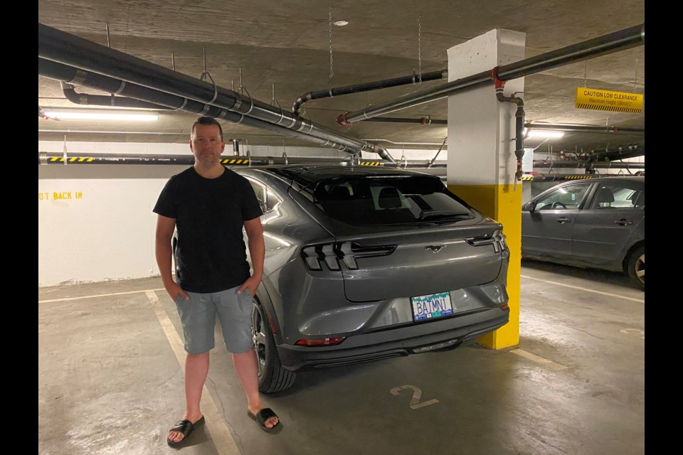 Murray Wasylnuk, with his electric Mustang that he's not allowed to charge up at his rental building