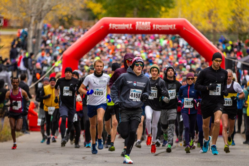 Participants in the five kilometre and 10 km distances race out of the start gate during the 40th annual Mel's Road Race in Banff on Saturday, (Sept. 28). Evan Buhler RMO PHOTO