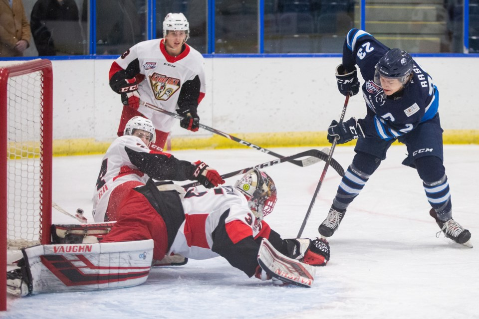 The Camrose Kodiaks Griffin Bowerman makes a save against Canmore Eagles Tian Rask during a game at the Canmore Recreation Centre on Friday (Nov. 1). Evan Buhler RMO PHOTO