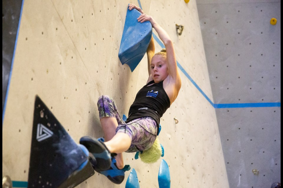 Canmore's Alexa Vanier climbs her last boulder problem during the qualification round of a bouldering competition at Elevation Place on Saturday (Nov. 23). EVAN BUHLER RMO PHOTO