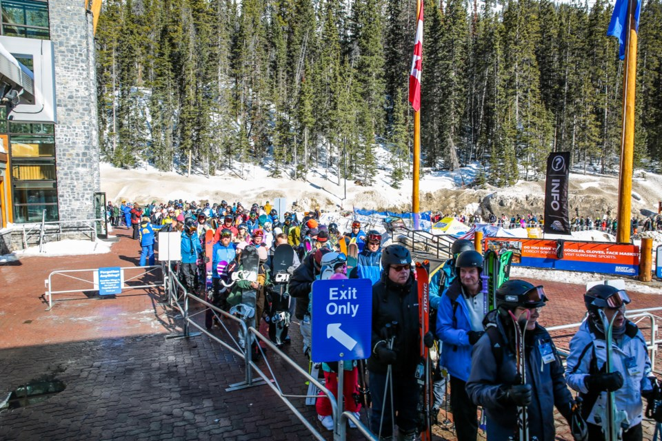 Guests wait in line to ride the access gondola at Sunshine Village in Banff National Park on Tuesday (March 17).  EVAN BUHLER RMO PHOTO⁠