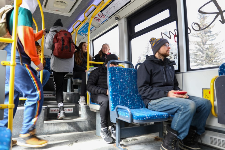 Two passengers walk onto a ROAM transit bus on Thursday (March 19).  EVAN BUHLER RMO PHOTO⁠
