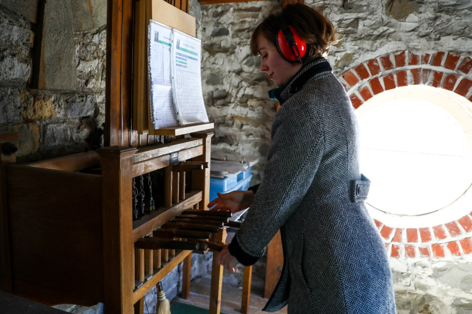 Heather Jordan, a music teacher in Banff, plays the bells at St. George's-in-the-Pines Anglican Church as a way to lift people's spirits since the spread of the novel coronavirus COVID-19 on Saturday (March 21). EVAN BUHLER RMO PHOTO
