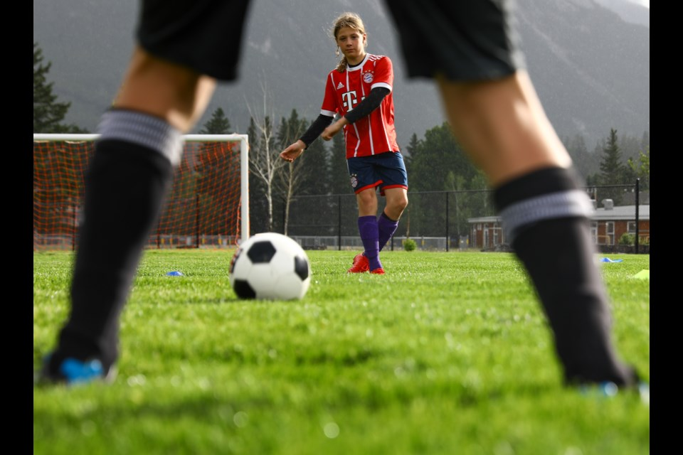 Torin Coneau passes the ball to a teammate during a U12-U15 boys Canmore Minor Soccer training session at Confederation Park in July. Canmore Minor Soccer returned to action with 95 registrants in training sessions only on July 2. EVAN BUHLER RMO PHOTO