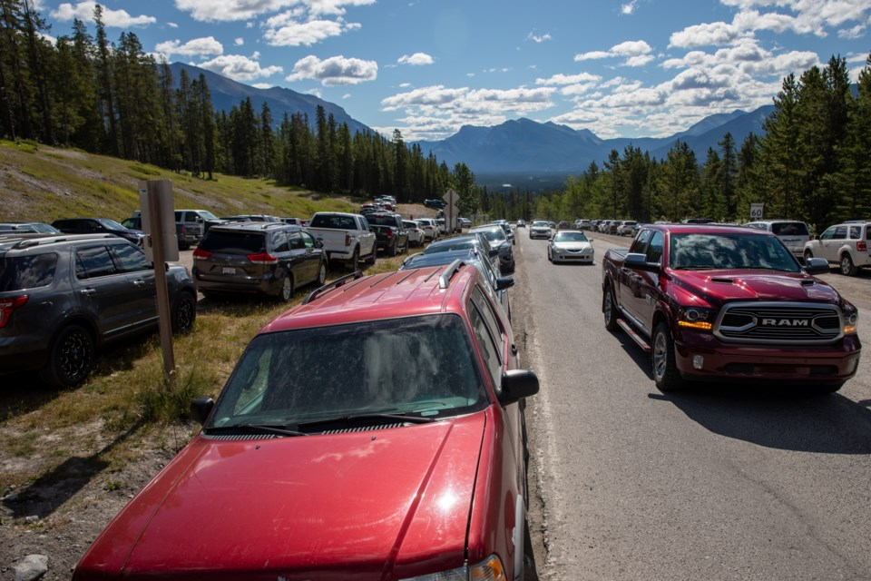 Motorists search for parking places at the Grassi Lakes overflow parkinglot  on Saturday (July 18). Thousands of tourists flocked to provincial parks to celebrate Alberta Parks Day. EVAN BUHLER RMO PHOTO