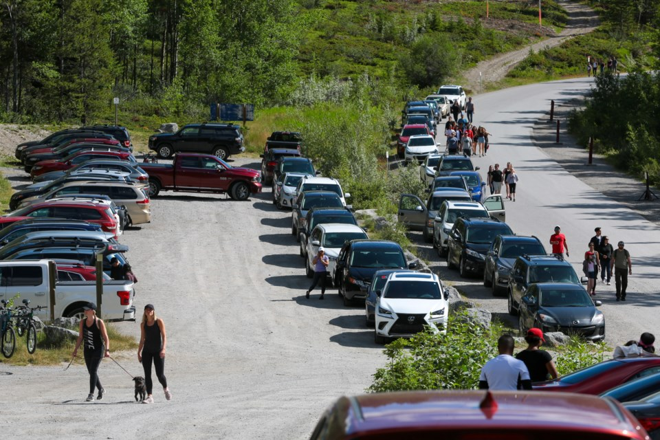 Motorists search for parking places at the Grassi Lakes trailhead on Saturday (July 18). Thousands of tourists flocked to provincial parks to celebrate Alberta Parks Day. EVAN BUHLER RMO PHOTO