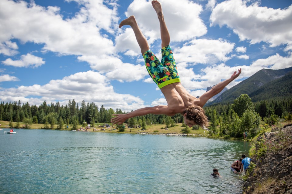 Bryce Golovach leaps from a cliff into Quarry Lake Park on Saturday (July 25). EVAN BUHLER RMO PHOTO