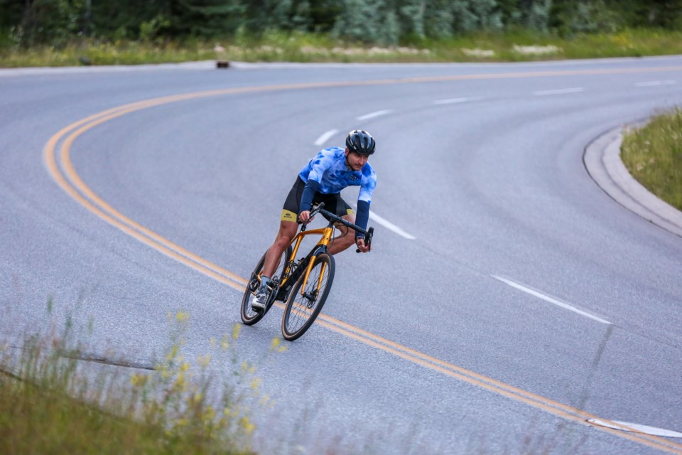 Dylan Dalgas cycles along Silvertip Trail in tandem with friends cycling on Vancouver Island to raise funds for Matthew Szymanowski on Saturday (July 25). Szymanowski suffered a serious injury to his spine after a collision with a car.  EVAN BUHLER RMO PHOTO