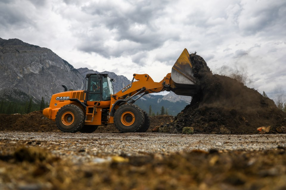 Clinton Whelan operates a front loader to turn a pile of compost at the Francis Cooke Class III Landfill and Resource Recovery Centre on Thursday (Aug. 6). EVAN BUHLER RMO PHOTO⁠