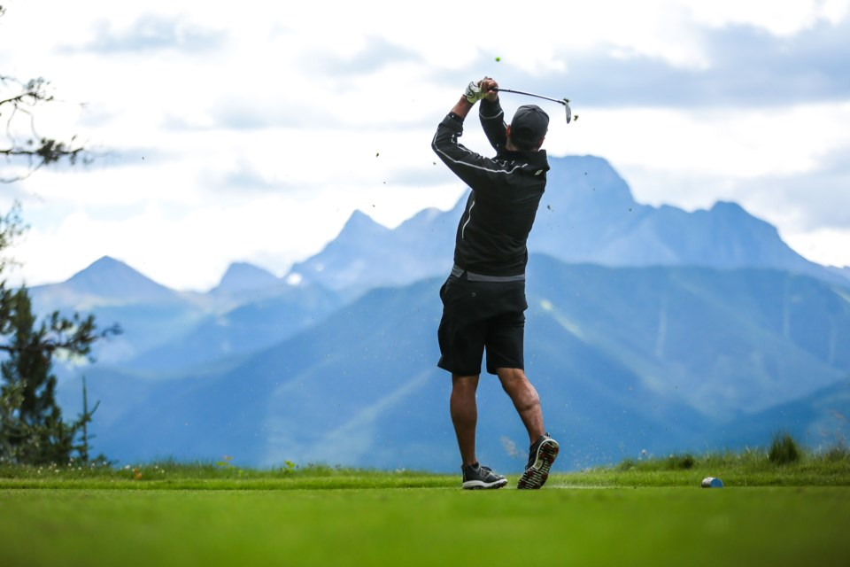 A golfers hits a tee shot on the 12th hole at Silvertip Resort on Friday (Aug. 7). This past July was the resort'€™s best month in the past 10 years and the rest of the season has followed that trend. EVAN BUHLER RMO PHOTO