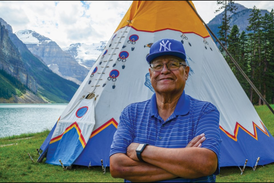 Bearspaw Councillor Rod Hunter poses for a picture in front of the Stoney Nakoda teepee at Lake Louise on Monday (Aug. 24). JENNA DULEWICH RMO PHOTO