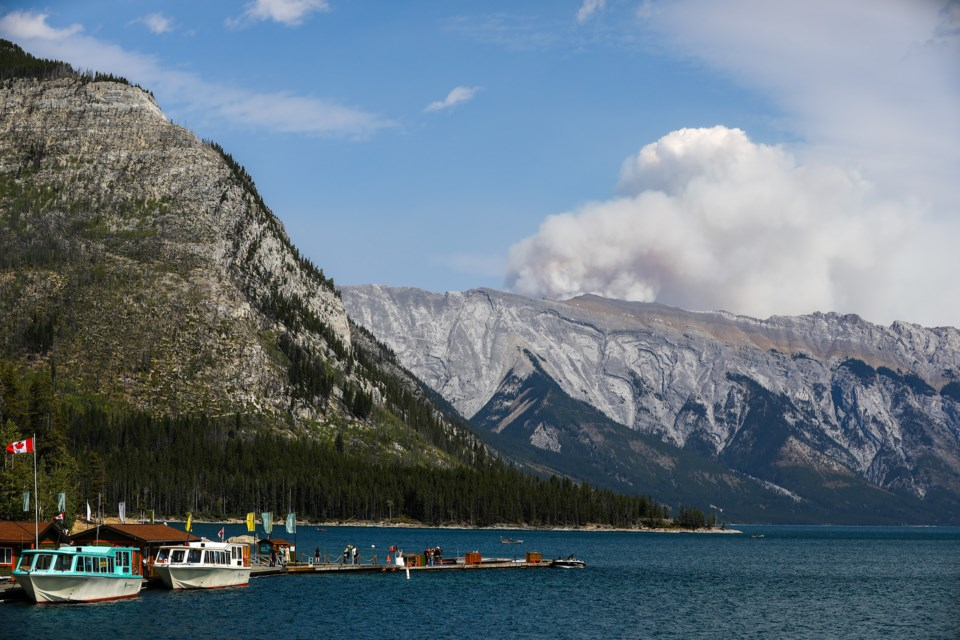 The smoke plume from a wildfire near Black Rock Mountain on the eastern border of Banff National Park is seen above Lake Minnewanka Saturday (Sept. 5). EVAN BUHLER RMO PHOTO