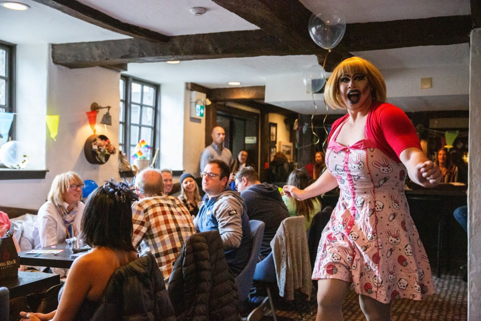 Drag performer Penny Tense lip sings a song in front of diners during Banff Pride Week's Drag Brunch at the Waldhaus on Saturday (Oct. 5). Evan Buhler RMO PHOTO