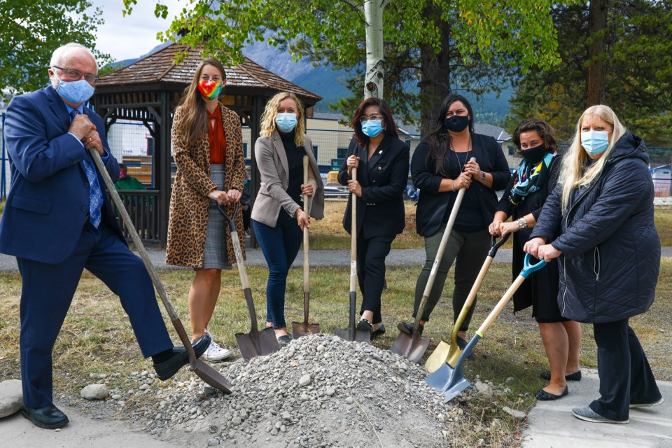 MD of Bighorn Reeve Dene Cooper, Banff Councillor Corrie DiManno, Banff-Kananaskis MLA Miranda Rosin, Alberta Seniors and Housing Minister Josephine Pon, Bow Valley Regional Housing vice-chair Lisa Rosvold and Canmore Councillors Joanna McCallum and Karen Marra break ground on the new seniors housing project at the Bow River Seniors Lodge on Wednesday (Sept. 23). EVAN BUHLER RMO PHOTO