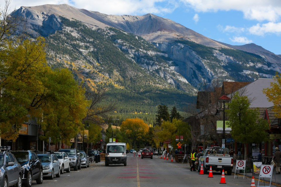 Vehicles drive along Main Street in Canmore after the Town reopened the street to vehicle traffic Thursday (Sept. 24). EVAN BUHLER RMO PHOTO
