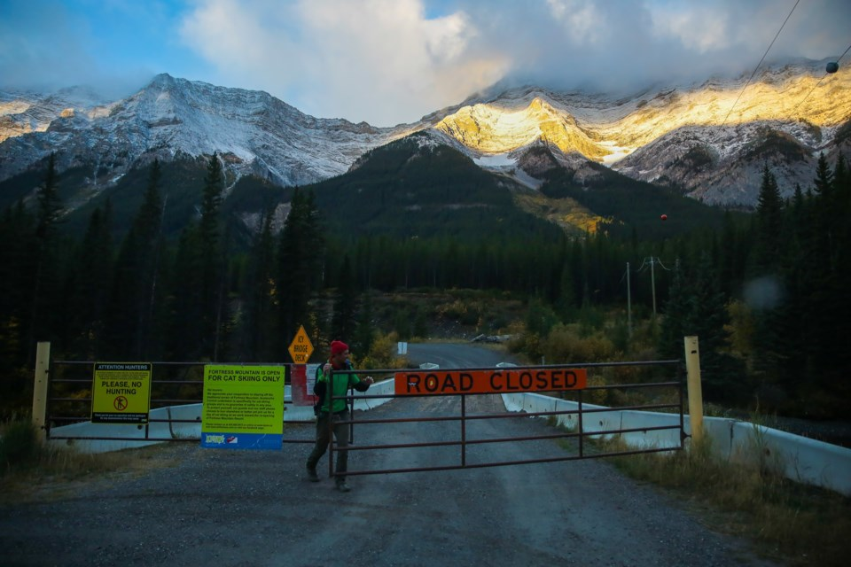 White Mountain Adventures guide Sam Campeau opens up the gate to Fortress Mountain on Saturday (Sept. 26). EVAN BUHLER RMO PHOTO