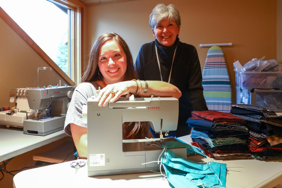 Canmore Mask Makers Sam Welsh and her mom Lorraine Lefort on Friday (Oct. 2). EVAN BUHLER RMO PHOTO