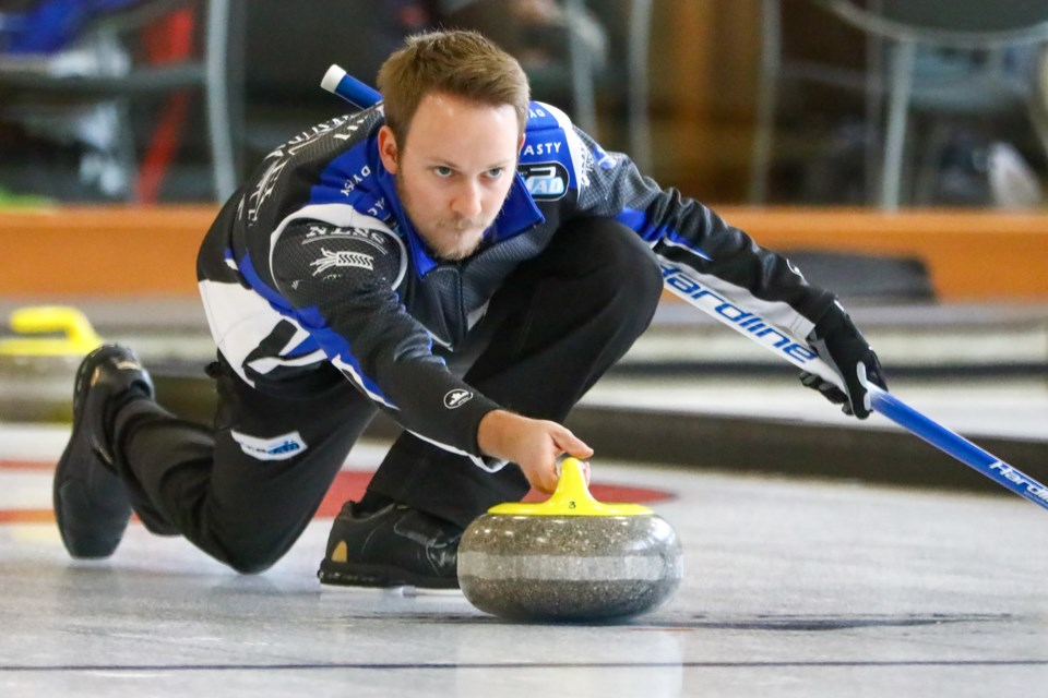 Skip Jeremy Harty throws the rock in the fifth end during the final match of the ATB Banff Classic at the Fenlands Banff Recreation Centre on Sunday (Oct. 18). Team Harty defeated Team Koe 8-4. EVAN BUHLER RMO PHOTO