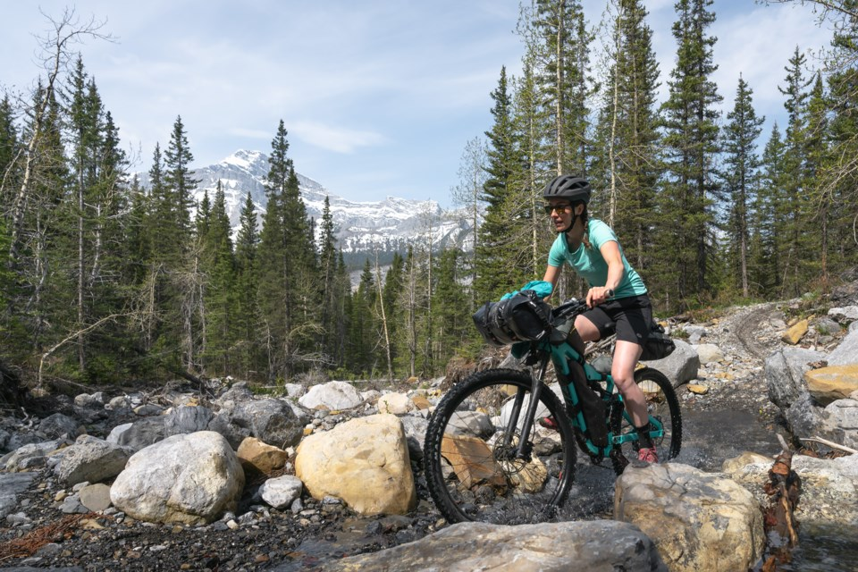 Sarah Hornby cycles on one of the routes created by her late husband Ryan Correy, which is featured in his new book Bikepacking in the Canadian Rockies. JEFF BARTLETT PHOTO