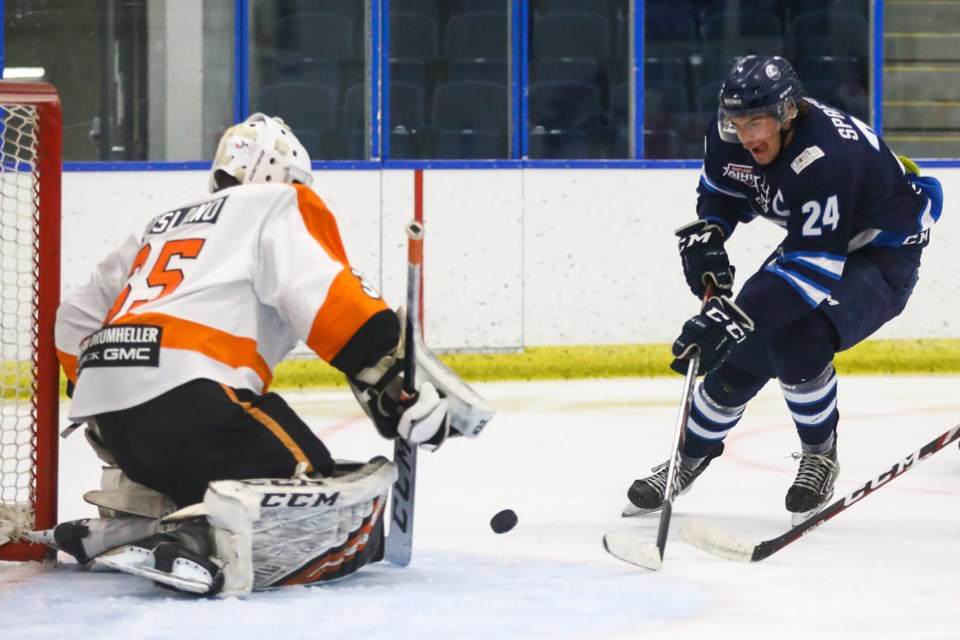 Canmore Eagles Michael Spafford takes a shot against the Drumheller Dragons goaltender Ryley Osland during a game at the Canmore Recreation Centre on Friday (Nov. 13). EVAN BUHLER RMO PHOTO