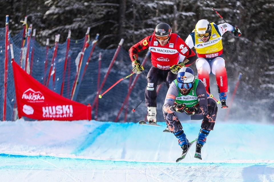 Filip Flisar of Slovenia leads the pack with Canada's Brady Leman and France's Arnaud Bovolenta giving chase in the men's qualifications during the 2020 Audi Ski Cross World Cup at Nakiska Ski Resort on Saturday (Jan. 18). EVAN BUHLER RMO PHOTO