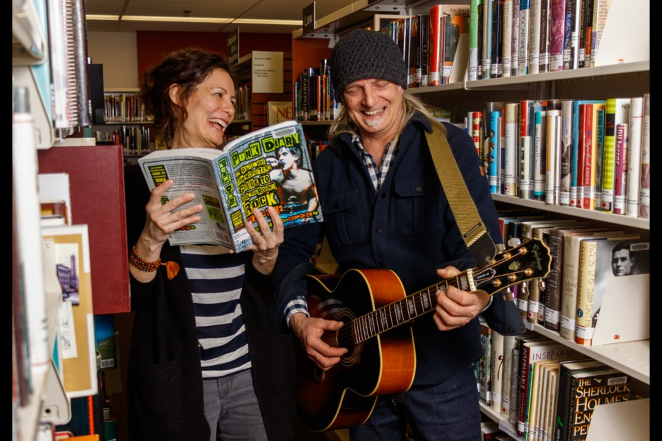Assistant library director Carey Lees, left, and musician Garry Gonis plan for the listening room featuring local musicians at the Banff Public Library Tuesday, Jan. 21, 2020. CHELSEA KEMP RMO PHOTO